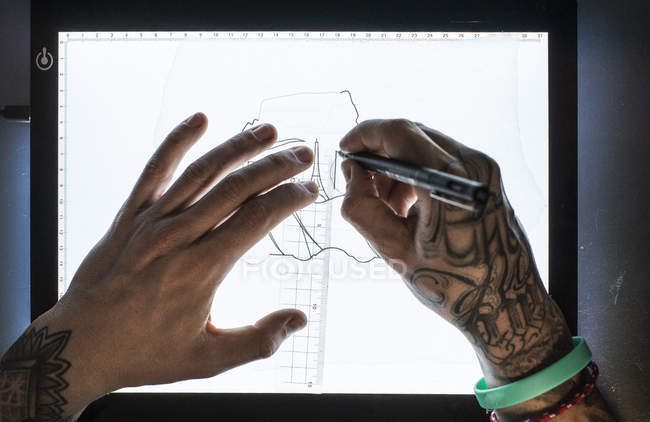Hands of master drawing sketch for tattoo — Stock Photo