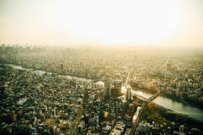 Aerial cityscape in bright sunlight — Stock Photo
