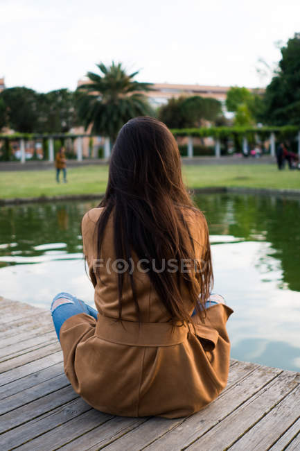 Girl relaxing on lake in part — Stock Photo