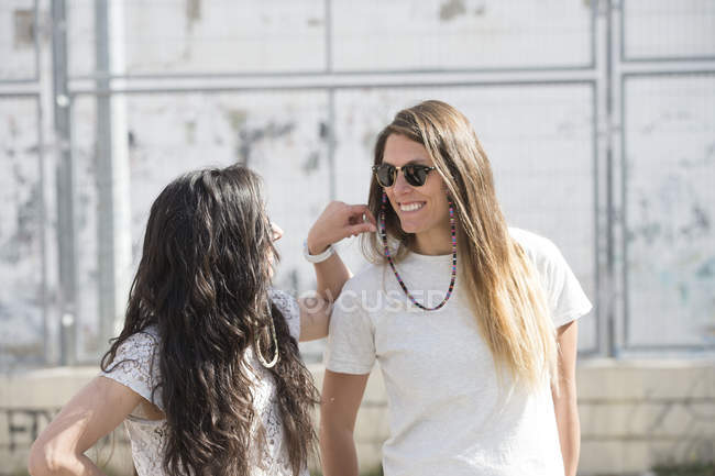 Playful happy girlfriends on street — Stock Photo