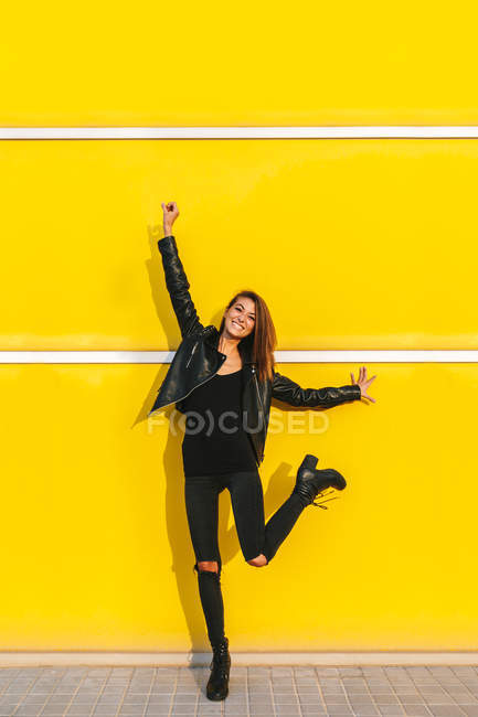 Fashion girl in leather coat posing — Stock Photo