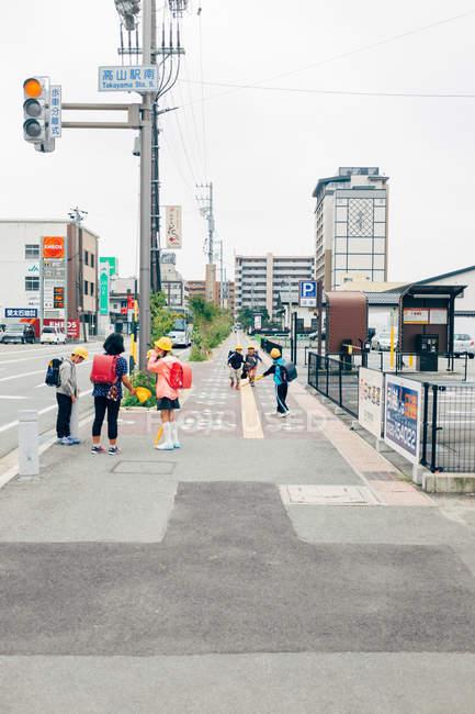 Children playing on a sidewalk — Stock Photo