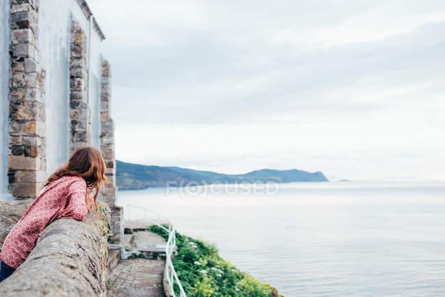 Person admiring coastline — Stock Photo