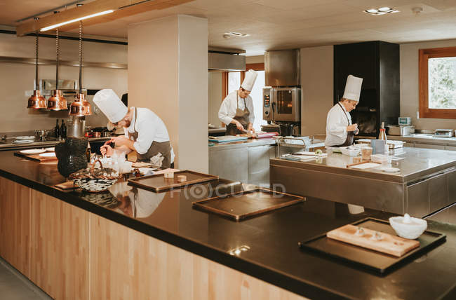 Professional cooks at work — Stock Photo