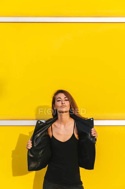 Fashion girl in coat posing — Stock Photo