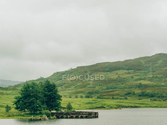 Mountain lake shore — Stock Photo
