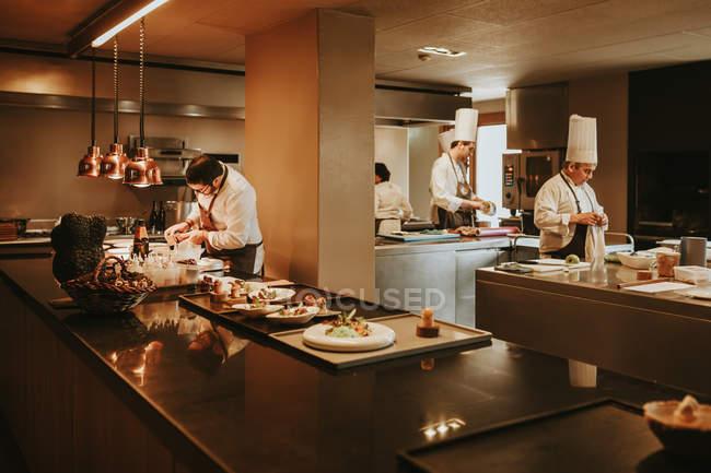 Restaurant staff in kitchen — Stock Photo