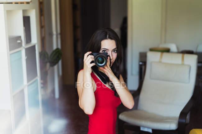 Woman posing with photo camera — Stock Photo