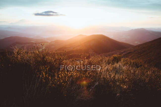 Bright sun in mountains — Stock Photo