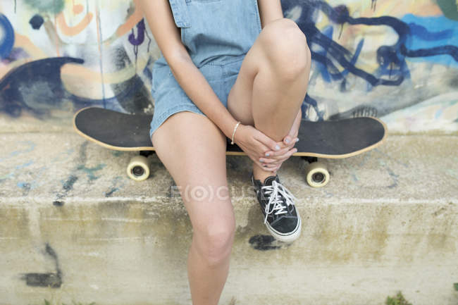 Crop woman with board at street — Stock Photo