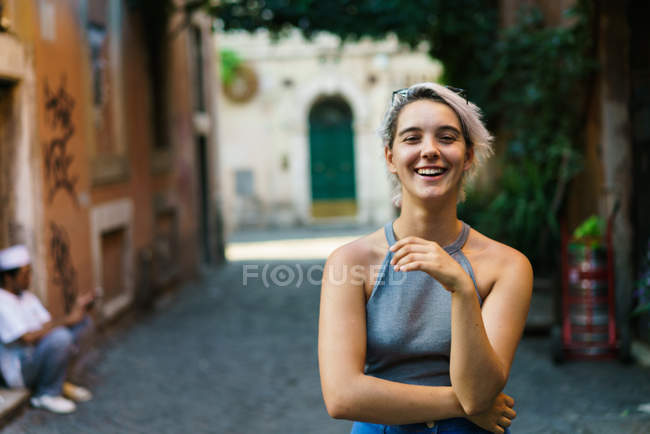 Charming flirty girl posing at street — Stock Photo