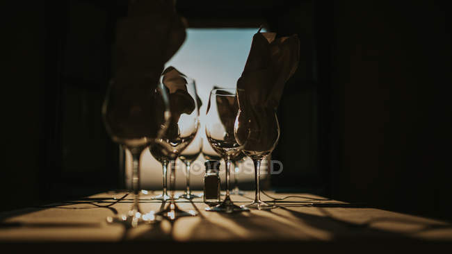 Wineglasses with napkins in darkness — Stock Photo