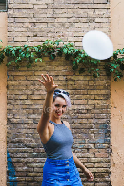 Charming woman posing with balloon — Stock Photo