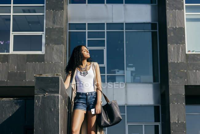 Cheerful woman walking on street — Stock Photo