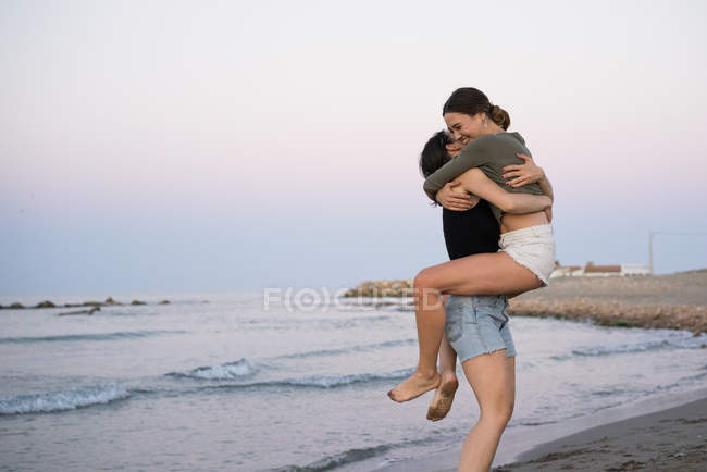 Embracing happy female couple — Stock Photo