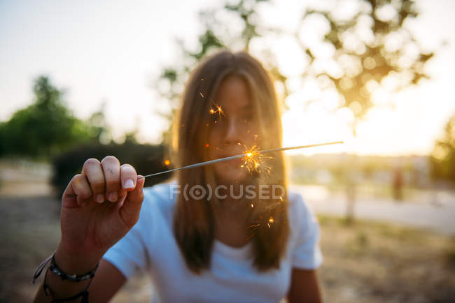 Woman with sparkling light — Stock Photo