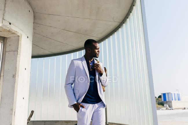 Fashionable black man on stairs — Stock Photo