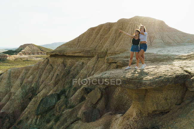 Excited women standing on cliff — Stock Photo
