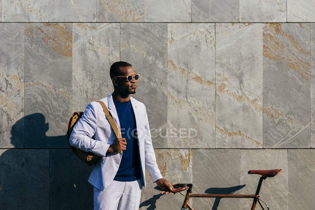 Trendy man with bicycle at street — Stock Photo
