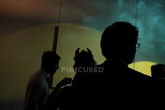 Silhouette of people in club on party. — Stock Photo