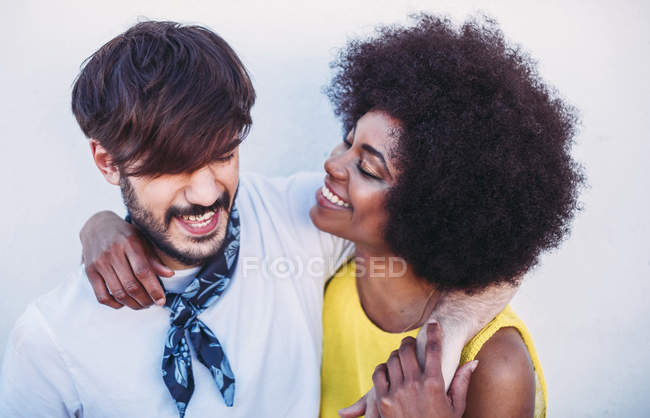 Interracial couple embracing and looking at each other — Stock Photo