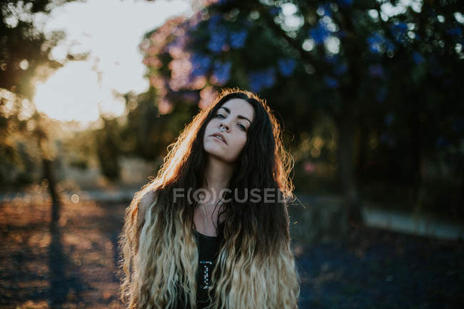 Portrait of provocative girl with nose piercing at evening dusk — Stock Photo
