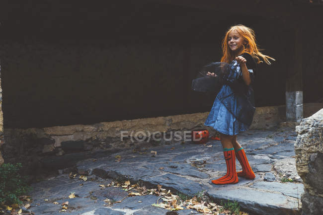 Girl in witch dress at street — Stock Photo