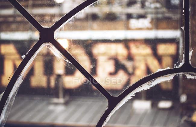 Sign plate seen through windows glass — Stock Photo