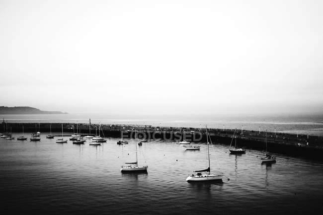 Aerial view of floating yacht at port on bright day — Stock Photo