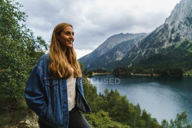Blond woman at lake — Stock Photo