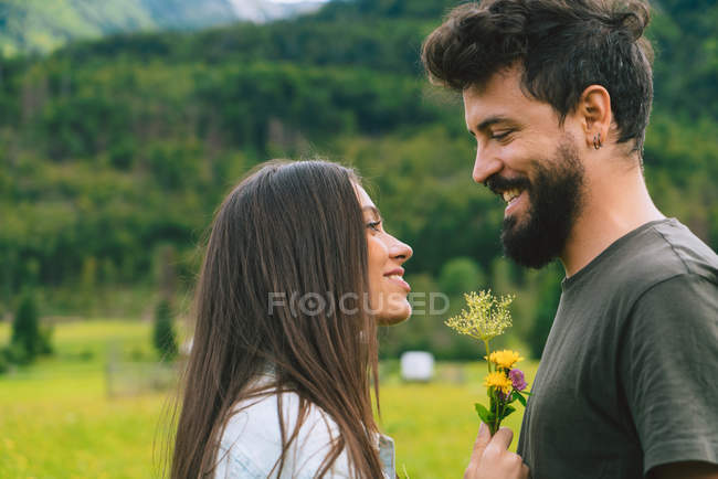 Couple looking at each other on meadow — Stock Photo