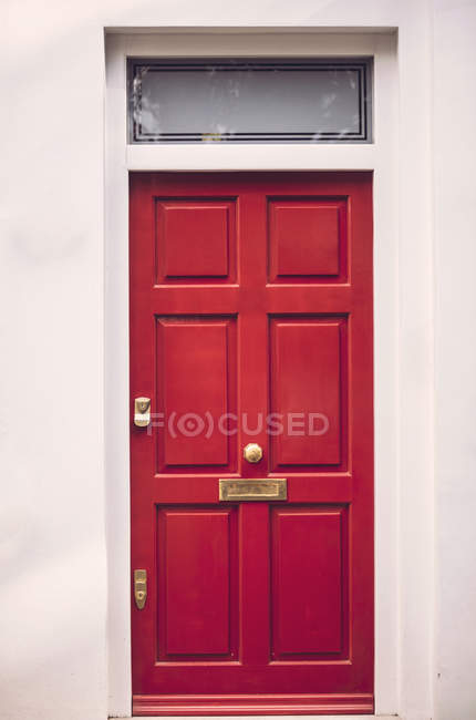 View of vibrant red entrance door — Stock Photo