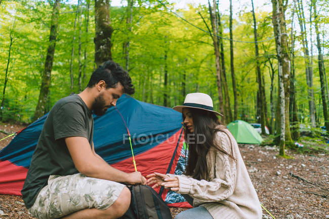 Couple at camp in woods — Stock Photo