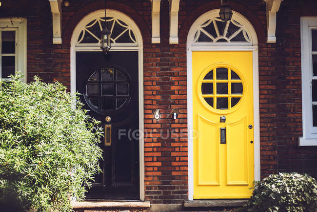 Black and yellow vintage doors — Stock Photo