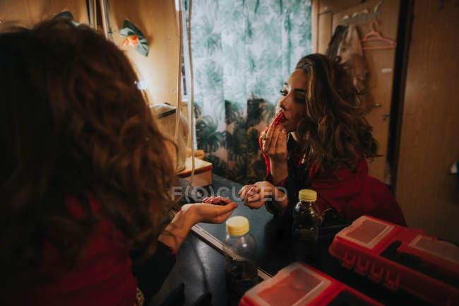 Woman using red lipstick — Stock Photo