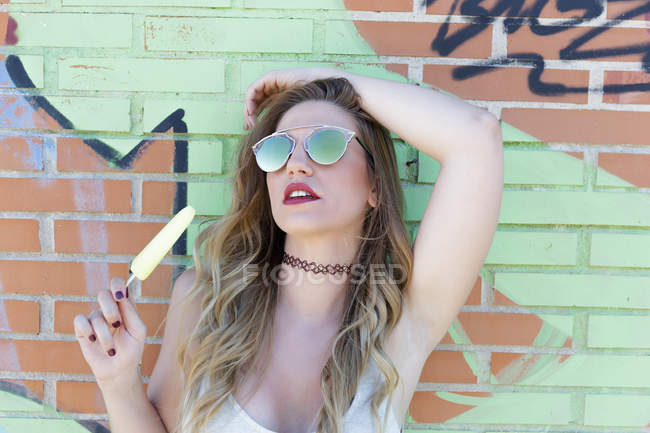 Girl in mirrored sunglasses posing with ice cream — Stock Photo