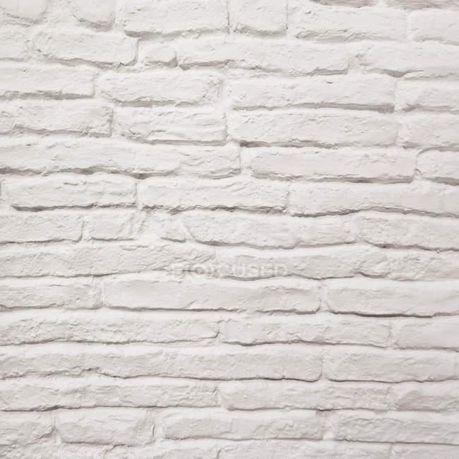Закрыть вид на текстуру стены из белого кирпича — стоковое фото