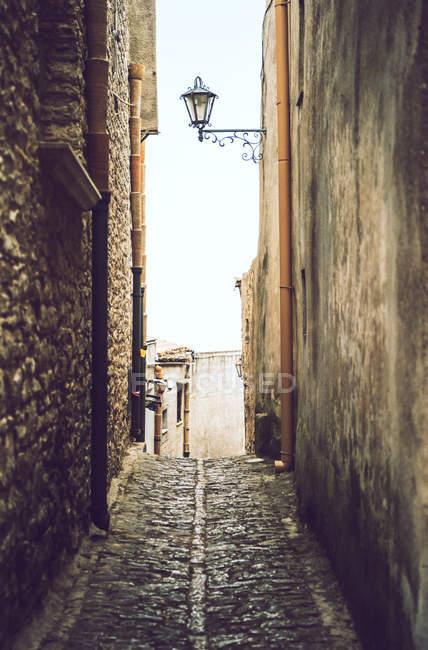 Lantern hanging medieval street lane — Stock Photo