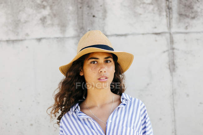 Girl in hat looking at camera — Stock Photo