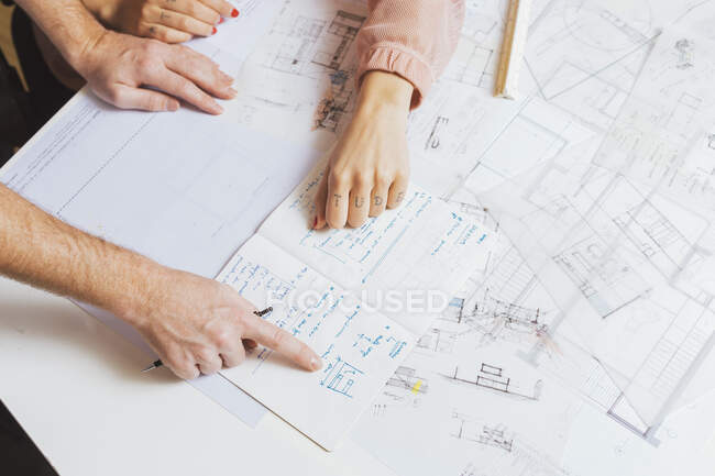 Top view of hands of male and female designers working with the plan — Stock Photo