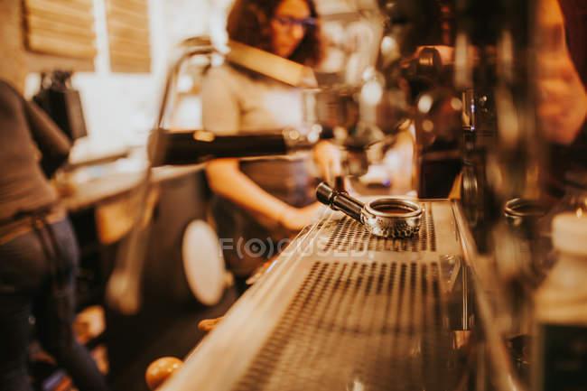 Metal holder lying on coffee machine at bar — Stock Photo