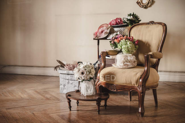Wedding bouquets of flowers on vintage armchair — Stock Photo