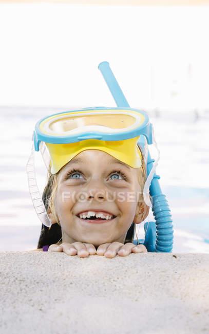 Kid in snorkel mask posing on poolside — Stock Photo