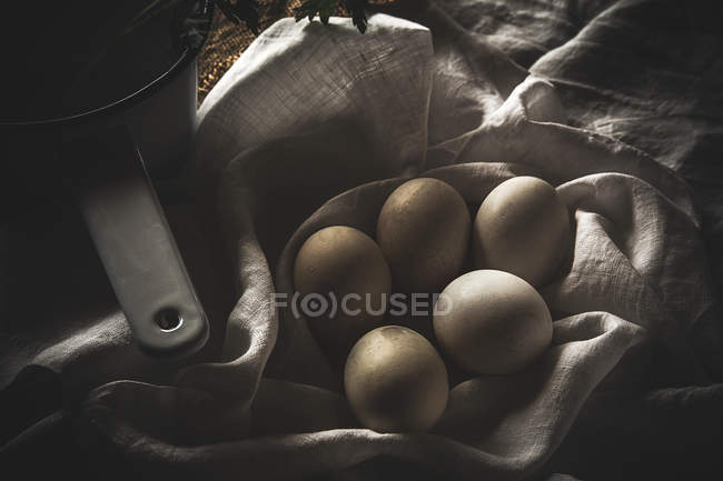 From above chiken eggs on rustic table with scoop — Stock Photo