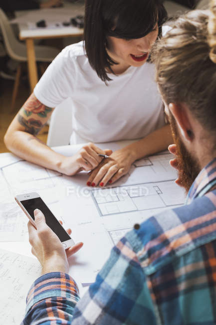 Two colleagues working on sketch — Stock Photo