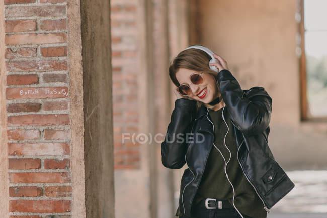 Girl in headphones looking down — Stock Photo