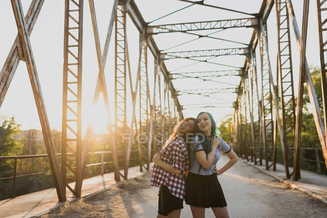 Girlfriends looking at camera — Stock Photo