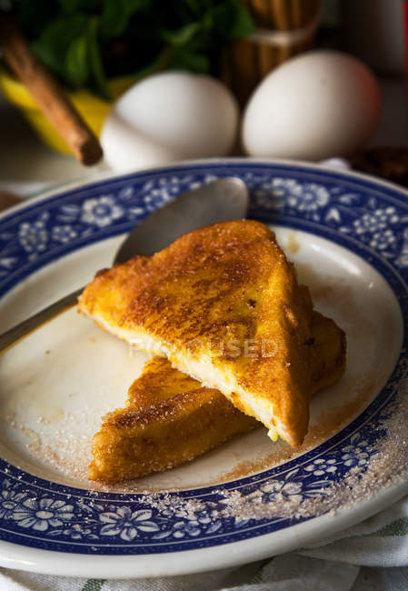 High angle view of sweet toasts on ceramic plate over towel — Stock Photo