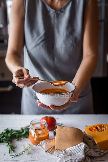 Woman with bowl of pumpkin soup — Stock Photo