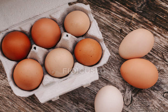 Eggs on wooden table — Stock Photo